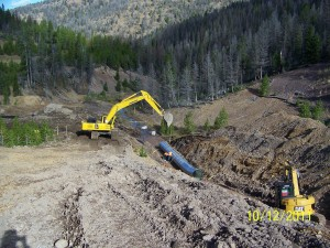 Installing conduit through the Mike Horse Dam