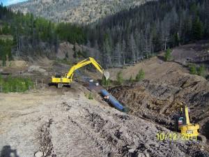 Installing conduit through the Mike Horse Dam